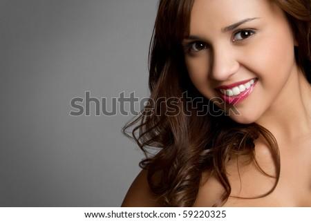 Beautiful young hispanic girl smiling - stock photo