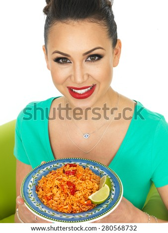Beautiful Young Hispanic Woman Holding A Plate of Spicy Mexican Fried Rice With Fresh Lime Against A White Background - stock photo
