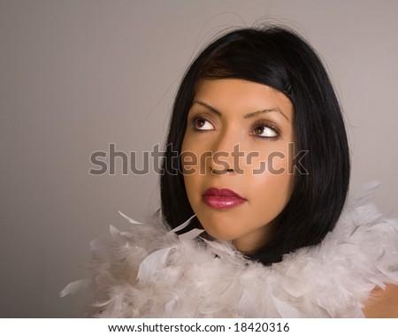 Beautiful Young Hispanic Woman on Gray Background - stock photo