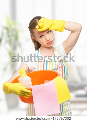 beautiful young housewife is tired of housework