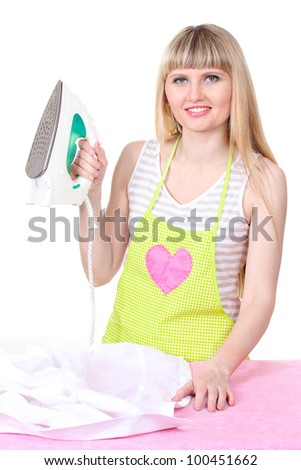 Beautiful young housewife with iron isolated on white - stock photo