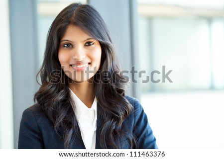 beautiful young indian businesswoman portrait in office - stock photo