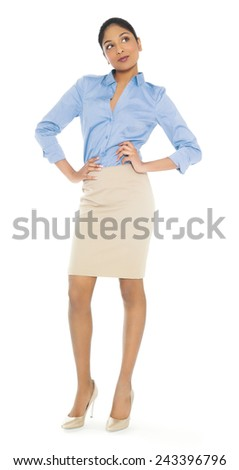Beautiful young Indian businesswoman posing on isolated white background. - stock photo