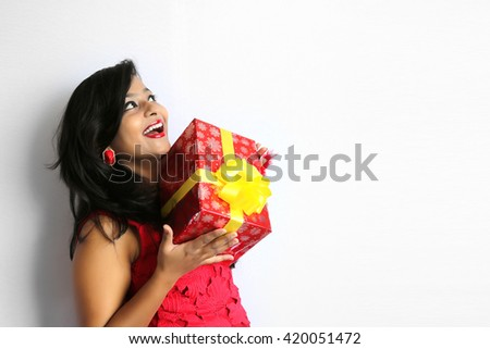 Beautiful young indian woman holding gift box Isolated on white background. - stock photo