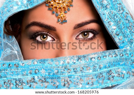 Beautiful young indian woman in traditional clothing with bridal makeup and jewelry. Beautiful Oriental eyes - stock photo