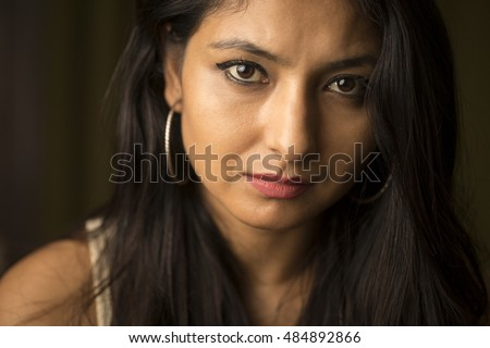 Beautiful young Indian woman portrait on dark background.