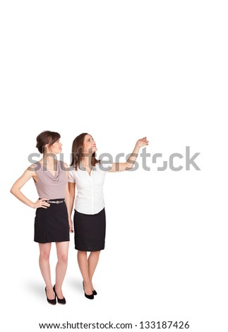 Beautiful young ladies gesturing with copy space