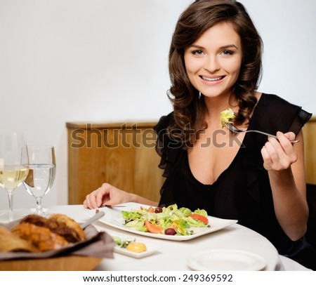 Beautiful young lady alone in restaurant  - stock photo