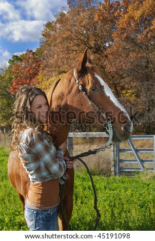 Beautiful Young lady and her brown horse