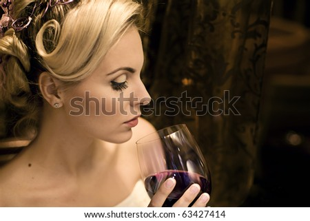 Beautiful young lady drinking red wine