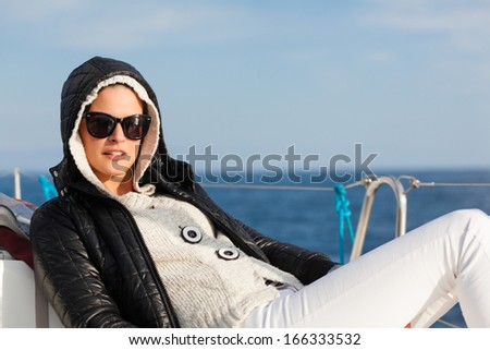 Beautiful young lady enjoying on a sailboat.Copy space - stock photo