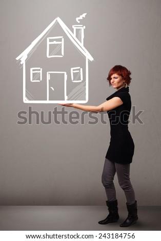 Beautiful young lady holding a huge drawn house - stock photo