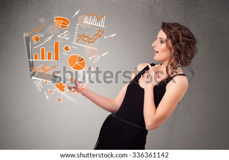 Beautiful young lady holding laptop with graphs and statistics - stock photo
