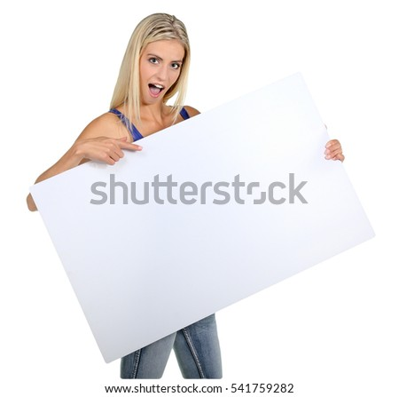 Beautiful young lady pointing to a sign board which she is holding
