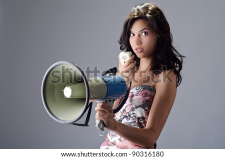 Beautiful young lady posing with a speaking-tube - stock photo