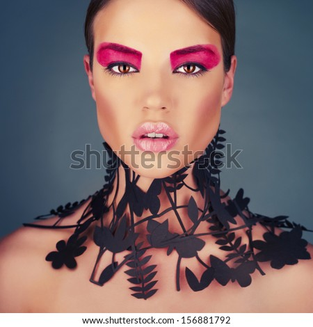 Beautiful young lady with a delicate floral pattern on neck. High-fashion collar - stock photo
