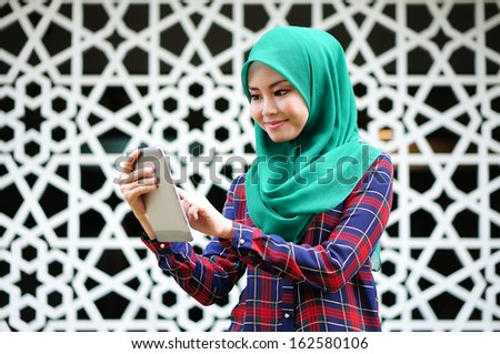 Beautiful young lady with tablet computer - stock photo