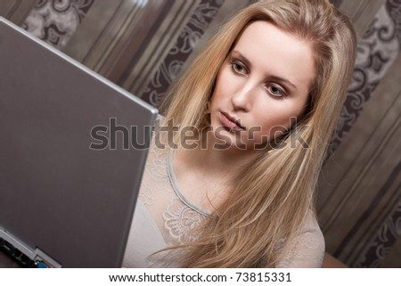 Beautiful young lady working on a computer - stock photo