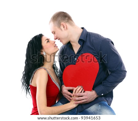Beautiful young love couple against on white background