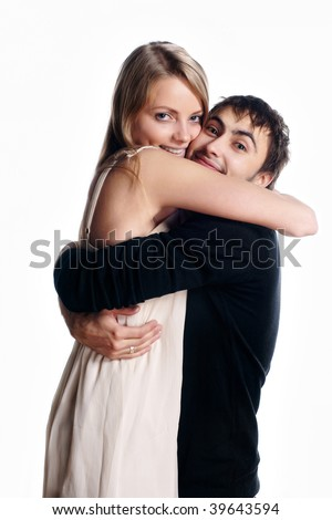 beautiful young lovers embrace - stock photo