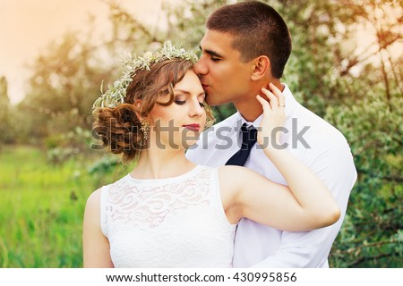 Beautiful young lovers in the olive trees. Wedding.