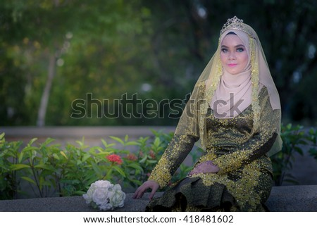 Beautiful young malay bride preparing for wedding