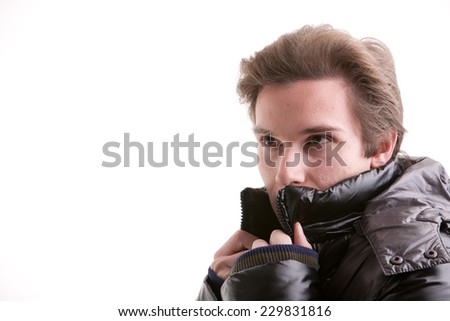 beautiful young man posing in winter with a warm anorak - stock photo