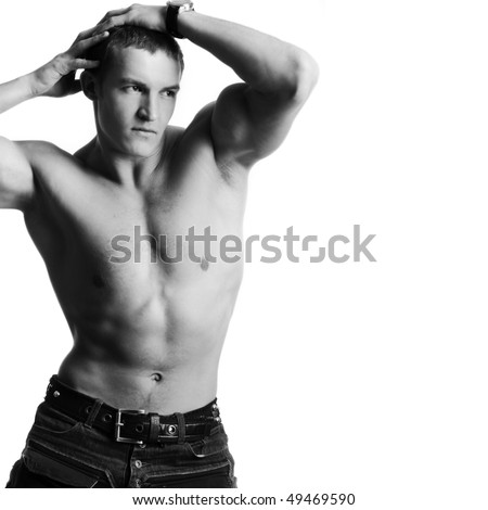 Beautiful young man posing on white background - stock photo