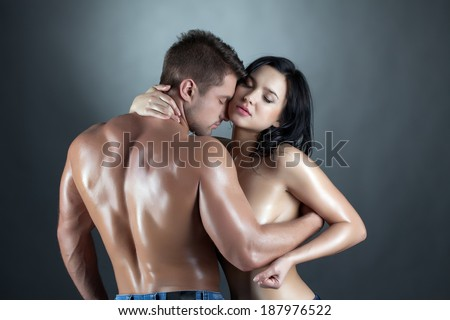 Beautiful young married couple hugging at camera - stock photo