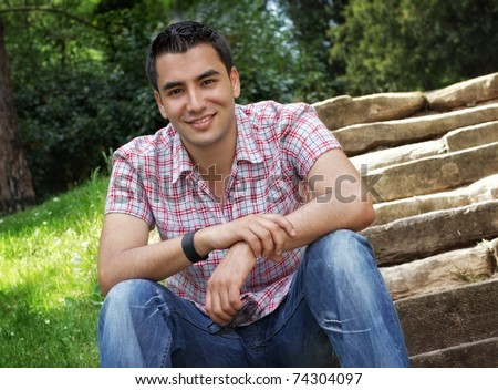 Beautiful young men sitting on stairway, outdoor -shot - stock photo
