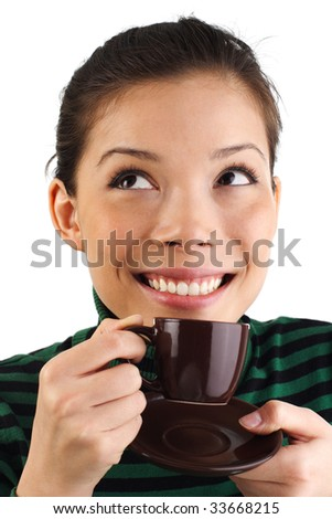 Beautiful young mixed asian / caucasian woman drinking espresso coffee while Looking to the upper corner. Isolated on white background. - stock photo