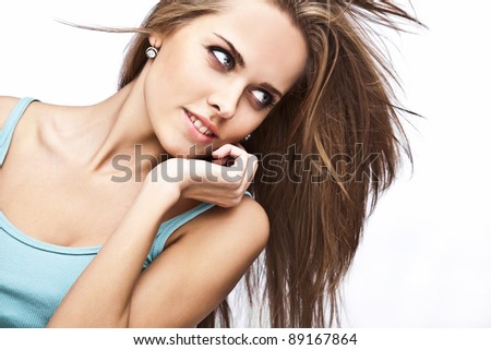 Beautiful young model in casual colorful t-shirt on white background. - stock photo
