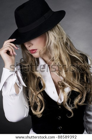 Beautiful young model in hat - stock photo