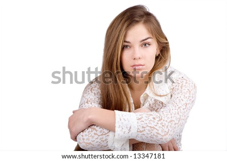 Beautiful young model sitting and looking at camera isolated on white background - stock photo