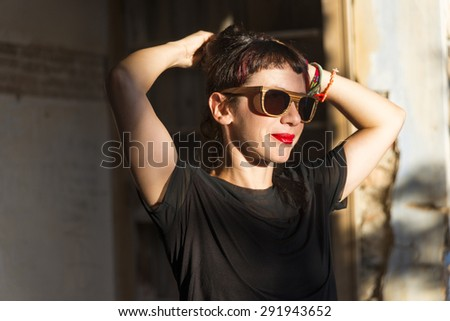 Beautiful young model wearing handmade wooden sunglasses.
