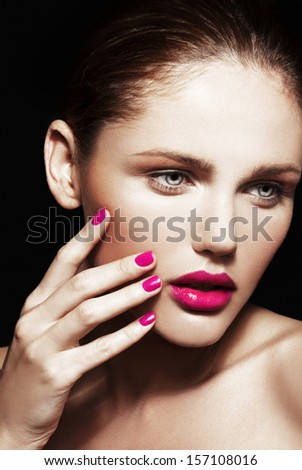 Beautiful young model with bright make-up and manicure. Close-up beauty portrait - stock photo