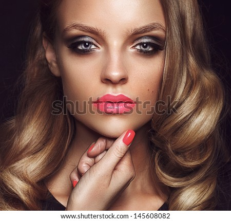 Beautiful young model with bright makeup and sunburn skin Evening make up, night, sunburn skin - stock photo