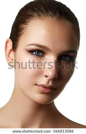 Beautiful young model with dark fashion make-up. Purity skin. Beauty style. Fashion shiny highlighter on skin, sexy gloss lips make-up and dark eyebrows - stock photo