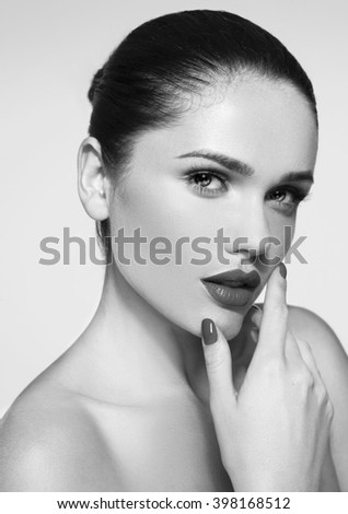 Beautiful young model with red lips and red manicure,fashion model