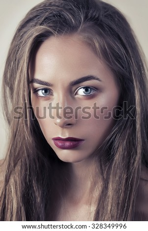 Beautiful young model with red lips. Gorgeous Woman Face. Bright makeup. - stock photo
