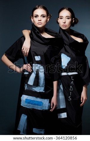 Beautiful young models  posing in the studio. - stock photo
