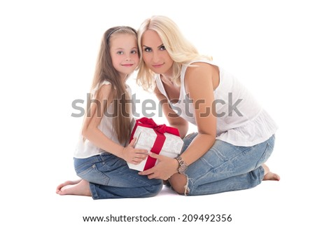 beautiful young mother and little daughter sitting with gift box isolated on white background