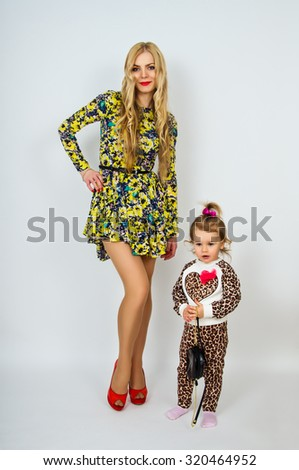 Beautiful young mother with her daughter - stock photo
