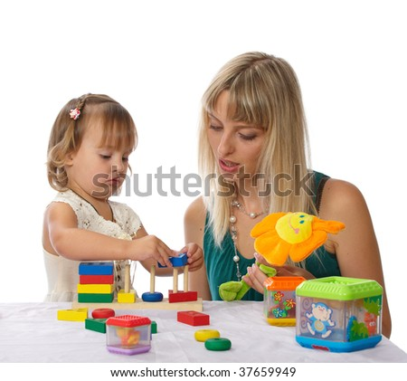 beautiful young mother with her daughter play with toys