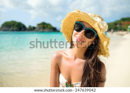 Beautiful young multicultural woman enjoying a Caribbean beach in Saint John in the United States Virgin Islands. - stock photo