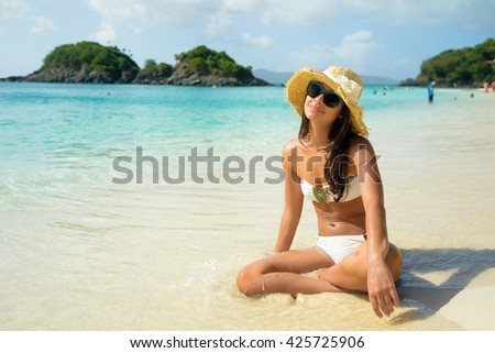 Beautiful young multicultural woman enjoying a Caribbean beach in Saint John in the United States Virgin Islands.
