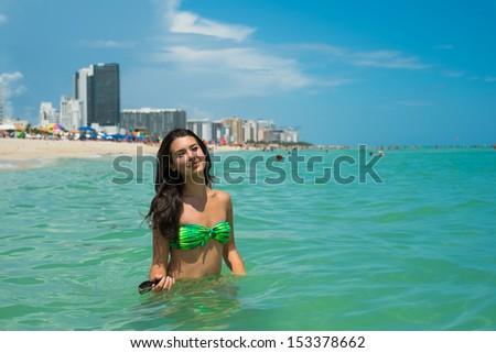 Beautiful young multicultural woman enjoying the beach. - stock photo