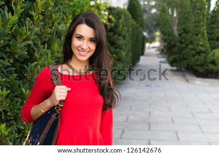 Beautiful young multicultural woman outdoor portrait. - stock photo