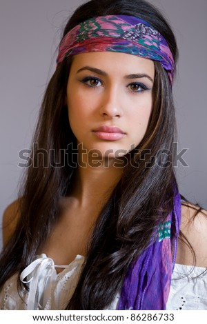 Beautiful young multicultural woman wearing a bandana.