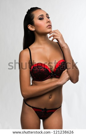 Beautiful young multiracial woman in red and black lingerie